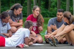 athletes in group small circle talking