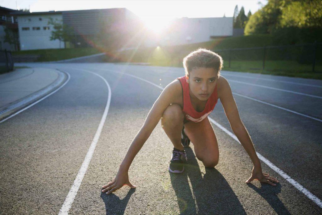 Focused female athlete on track