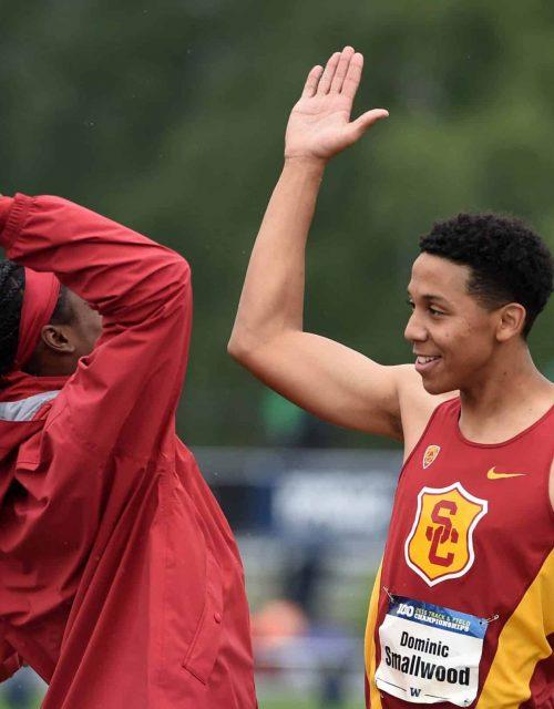 Track Athletes High-Five