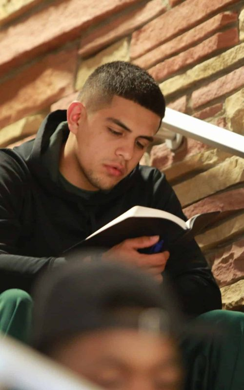 Male athlete reading Bible