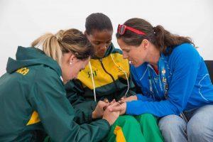 Three women praying together