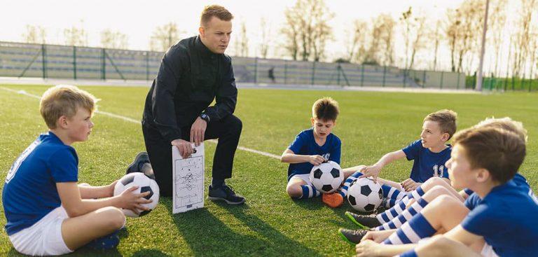 coach leading boys's soccer