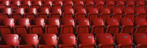 empty red stadium chairs