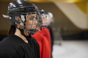 Female hockey player staring ahead