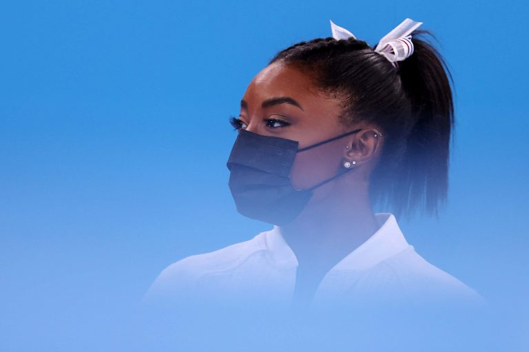 Profile picture of Simone Biles in front of powder blue background
