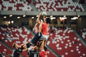 two teams grabbing for ball in the air