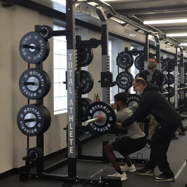 Jeff Friday working out Samson, one of the first athletes to train in the Sports Performance Center