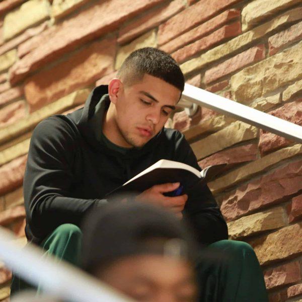 Male Reading Bible Inside