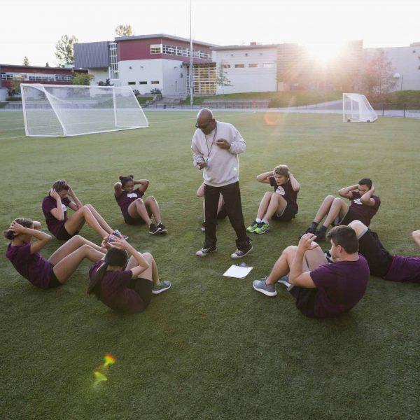 High school physical education teacher students sit-ups