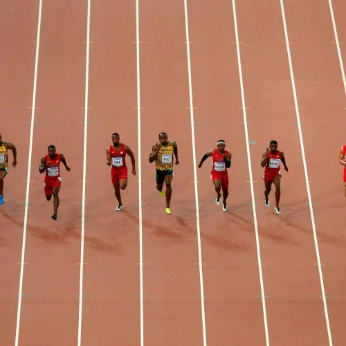 BEIJING, CHINA - AUGUST 23:  Usain Bolt of Jamaica (C) wins gold ahead of (L-R) Andre De Grasse of Canada, Asafa Powell of Jamaica, Justin Gatlin of the United States, Tyson Gay of the United States, Mike Rodgers of the United States, Trayvon Bromell of the United States, Bingtian Su of China and Jimmy Vicaut of France as they cross the finish line in the Men's 100 metres final during day two of the 15th IAAF World Athletics Championships Beijing 2015 at Beijing National Stadium on August 23, 2015 in Beijing, China.  (Photo by Lintao Zhang/Getty Images for IAAF)