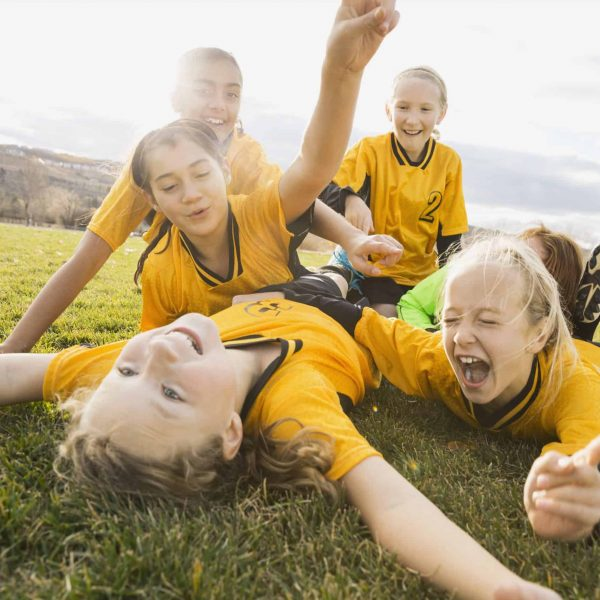 Excited soccer players celebrating on field